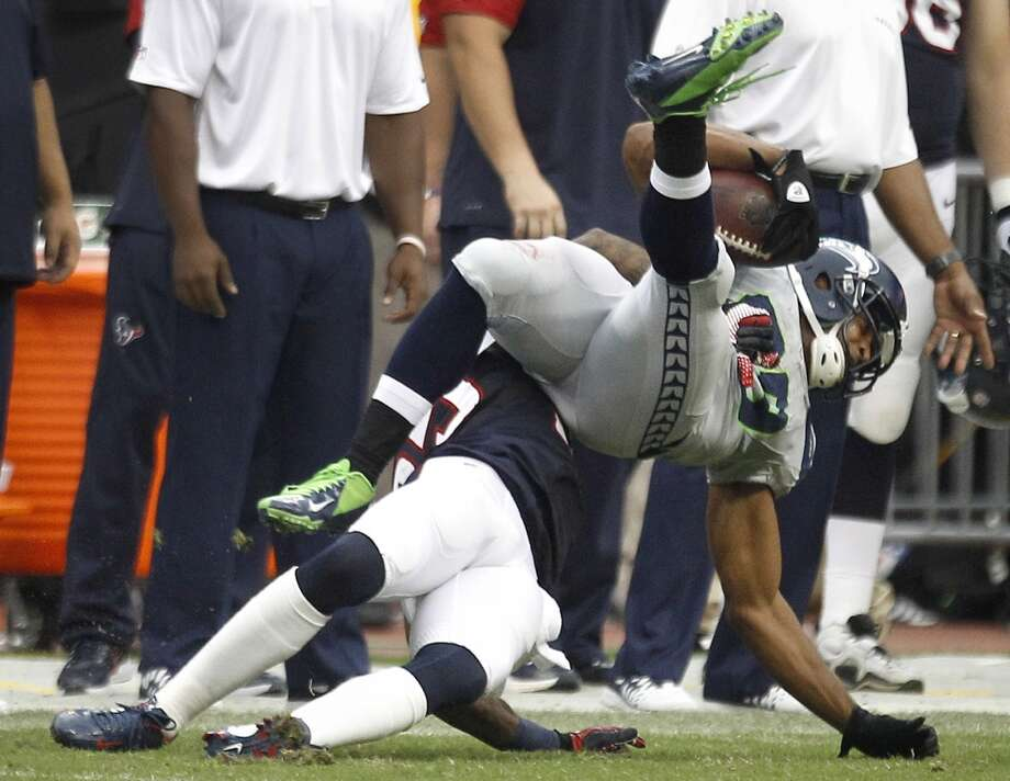 Texans cornerback Kareem Jackson (25) slams Seahawks wide receiver Doug Baldwin (89) to the turf in overtime. Jackson was penalized for a personal foul on the play, giving the Seahawks a first down. Photo: Brett Coomer, Houston Chronicle