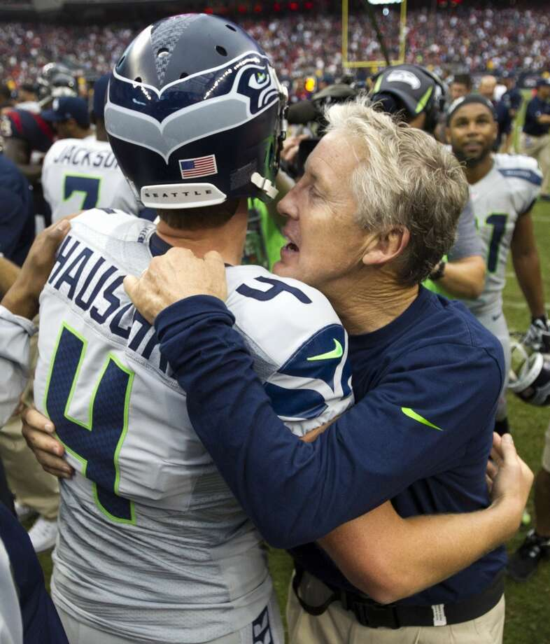 Seahawks head coach Pete Carroll embraces kicker Steven Hauschka after Hauschka kicked a 45-yard field goal for the victory. Photo: Brett Coomer, Houston Chronicle