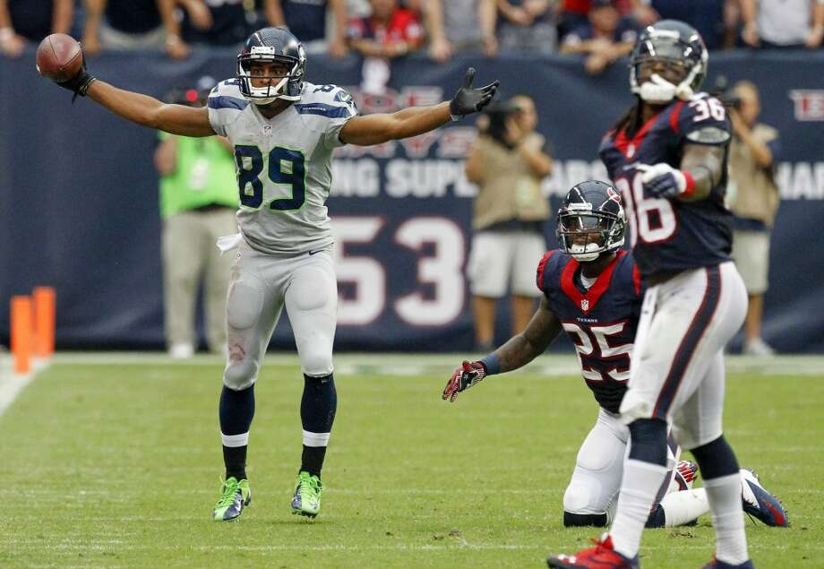 Seahawks wide receiver Doug Baldwin, left, reacts after Texans cornerback Kareem Jackson, center, threw him to the ground. Officials called a personal foul on Jackson giving the Seahawks a first down during overtime advancing them to the opportunity to kick the game-winning field goal. Photo: Cody Duty, Houston Chronicle