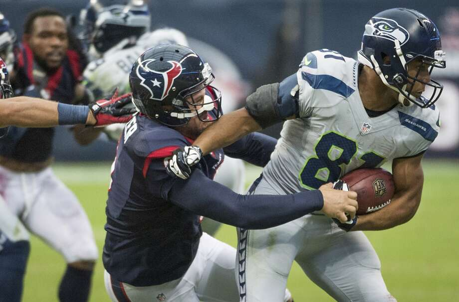 Texans punter Shane Lechler (9) makes a tackle on Seahawks punt returner Golden Tate. Photo: Smiley N. Pool, Houston Chronicle
