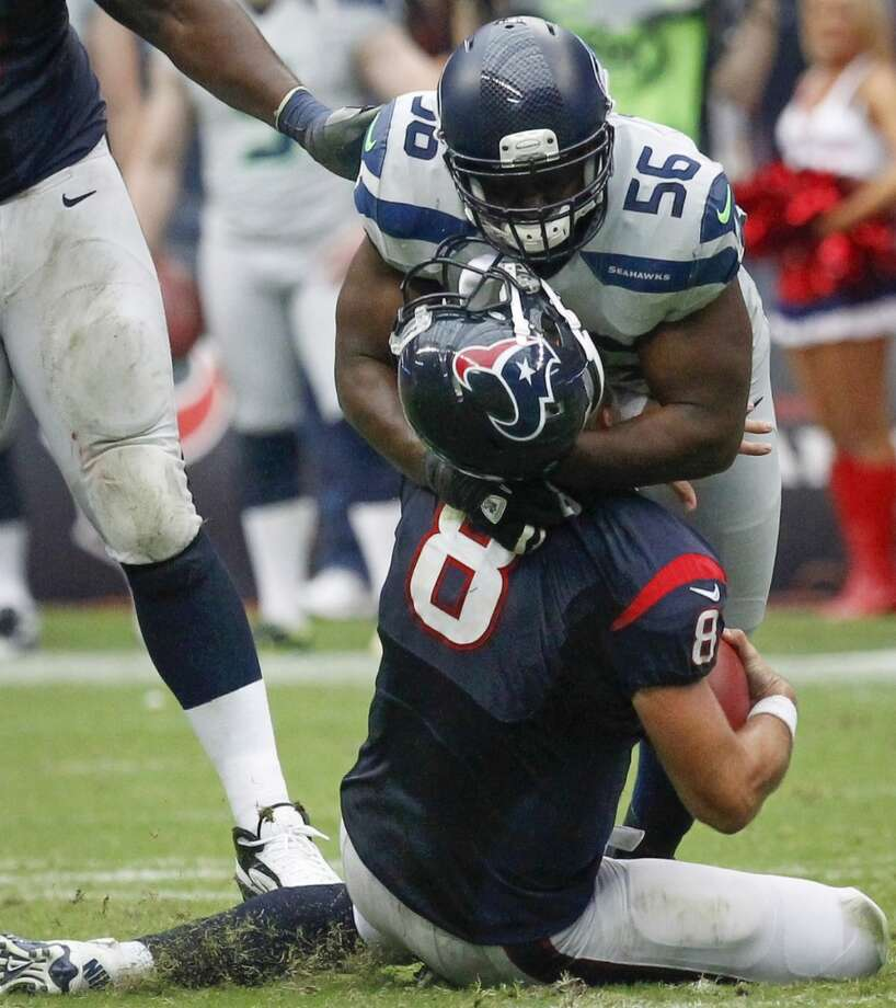 Seahawks defensive end Cliff Avril sacks Texans quarterback Matt Schaub during the fourth quarter. Photo: Cody Duty, Houston Chronicle