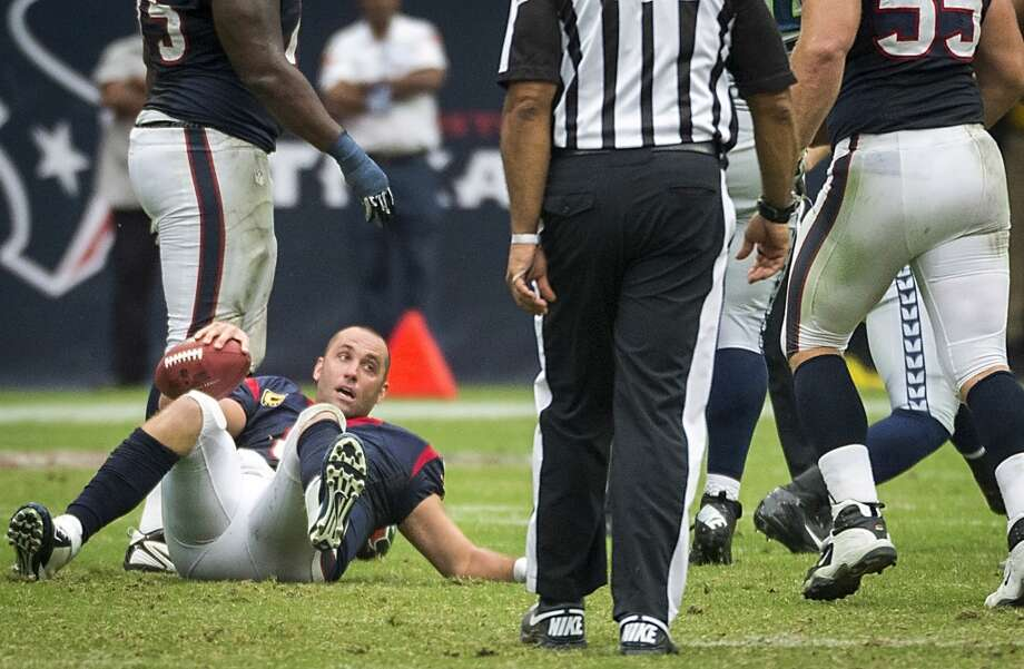 Texans quarterback Matt Schaub gets up after being sacked. Photo: Smiley N. Pool, Houston Chronicle
