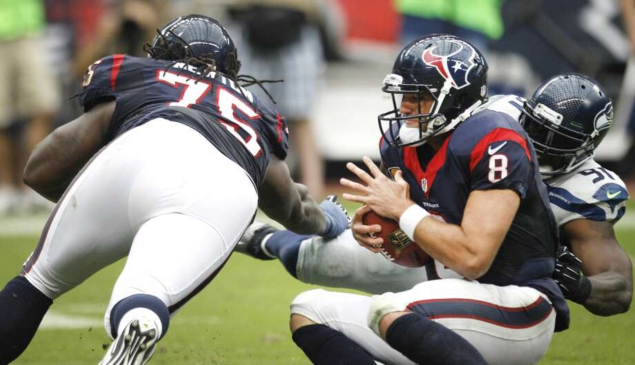 Texans quarterback Matt Schaub is sacked by Seahawks defensive end Chris Clemons after he beat tackle Derek Newton. Photo: Brett Coomer, Houston Chronicle