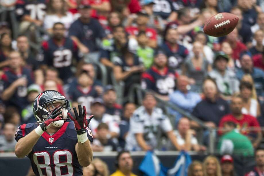 Texans tight end Garrett Graham hauls in a 31-yard touchdown pass during the first half. Photo: Smiley N. Pool, Houston Chronicle