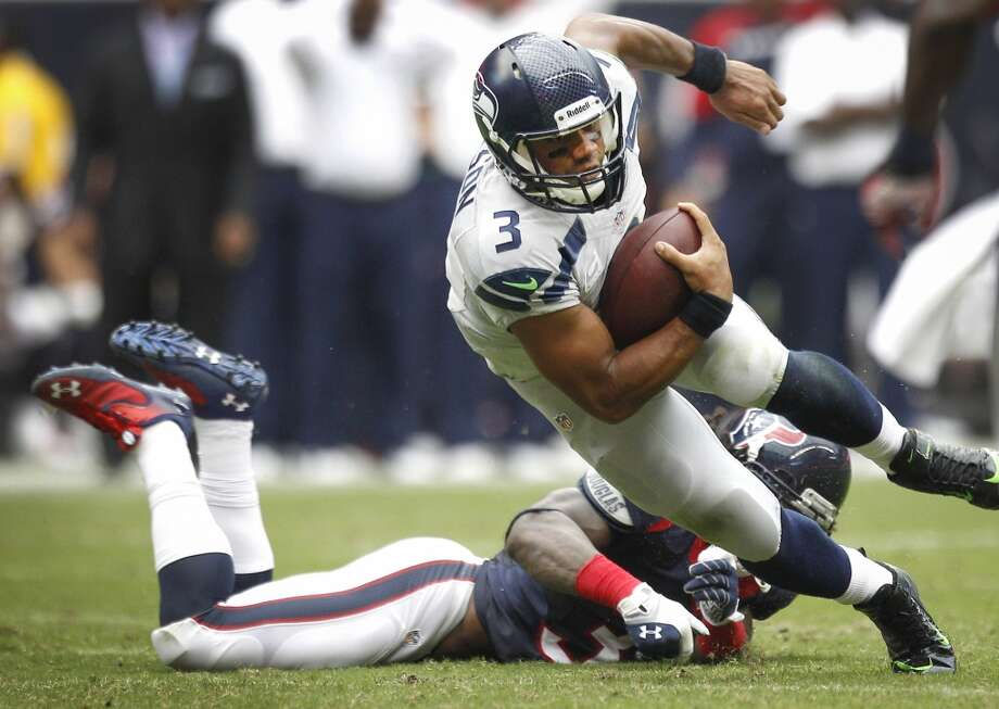 Seahawks quarterback Russell Wilson is forced out of the pocket by Texans strong safety D.J. Swearinger. Photo: Brett Coomer, Houston Chronicle