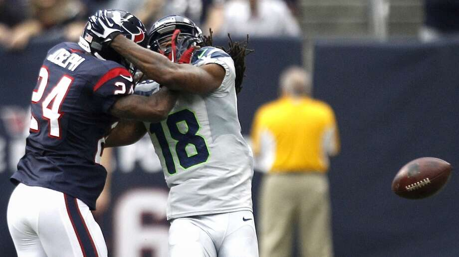 Texans cornerback Johnathan Joseph breaks up a pass intended for Seahawks wide receiver Sidney Rice. Photo: Brett Coomer, Houston Chronicle