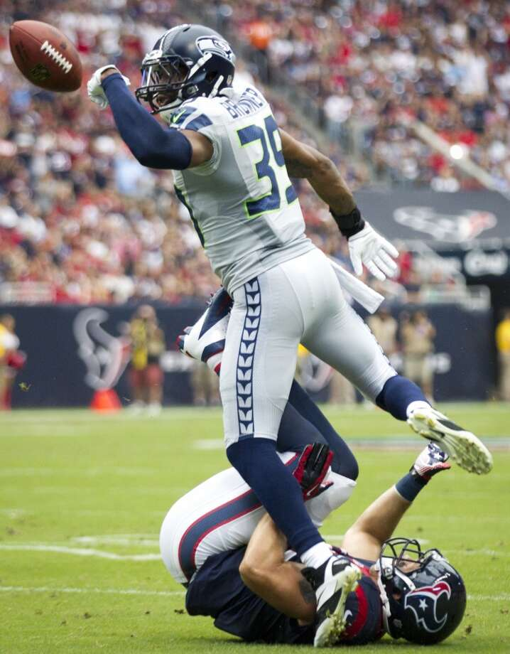 Seahawks cornerback Brandon Browner breaks up a pass intended for Houston Texans tight end Owen Daniels during the first quarter. Seahawks free safety Earl Thomas (29) intercepted the pass on the play. Photo: Brett Coomer, Houston Chronicle