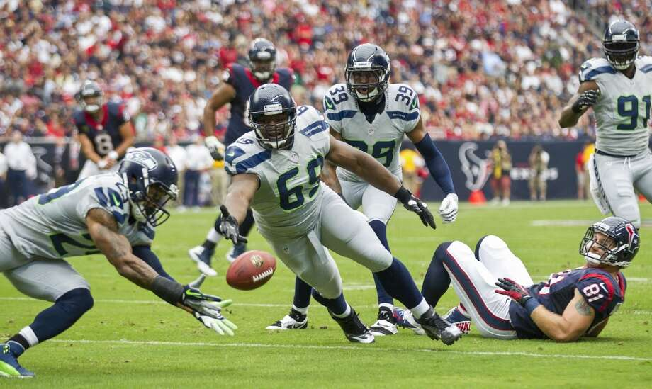 Seahawks free safety Earl Thomas (29) dives to intercept a pass by Texans quarterback Matt Schaub during the first quarter. Photo: Brett Coomer, Houston Chronicle