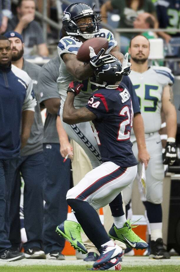 Texans cornerback Johnathan Joseph commits a pass interference penalty on a pass intended for Seahawks wide receiver Sidney Rice. Photo: Smiley N. Pool, Houston Chronicle