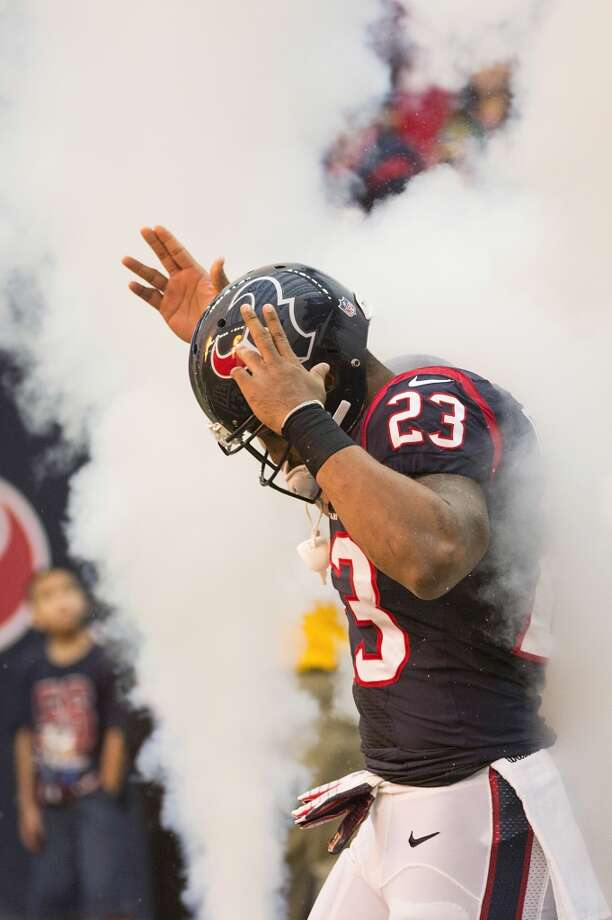 Texans running back Arian Foster takes the field before the game. Photo: Smiley N. Pool, Houston Chronicle