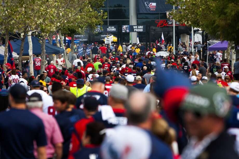 Texans fans wait to cross the street before the Texans take on the Seahawks at Reliant Stadium. Photo: Cody Duty, Houston Chronicle