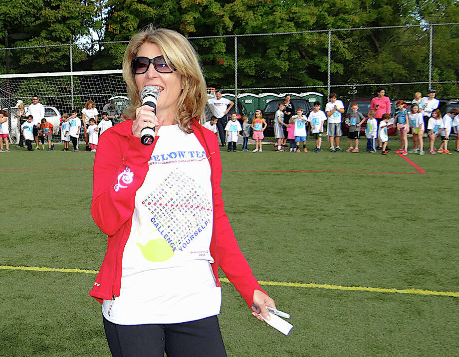 Bigelow Tea President and CEO Cindi Bigelow welcomes the crowd to the 26th annual Bigelow Tea Community Challenge on Sunday morning at Wakeman Boys & Girls Club. Photo: Mike Lauterborn / Fairfield Citizen contributed