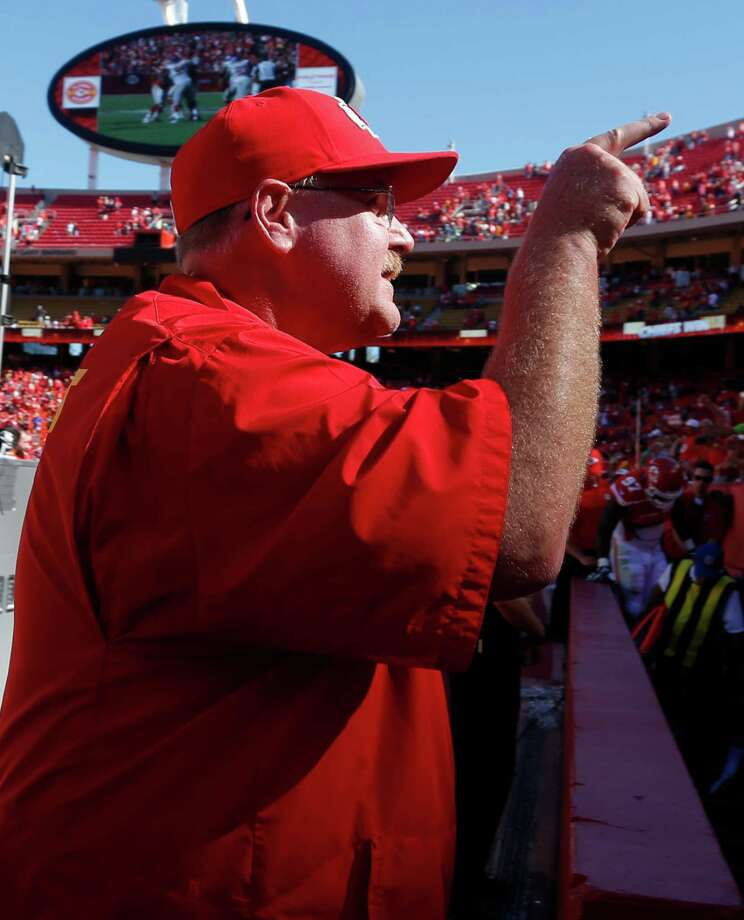 Kansas City Chiefs coach Andy Reid point to the stands following an NFL football game against the New York Giants at Arrowhead Stadium in Kansas City, Mo., Sunday, Sept. 29, 2013. The Chiefs defeated the Giants 31-7. (AP Photo/Ed Zurga) ORG XMIT: MOOW125 Photo: Ed Zurga / FR34145 AP