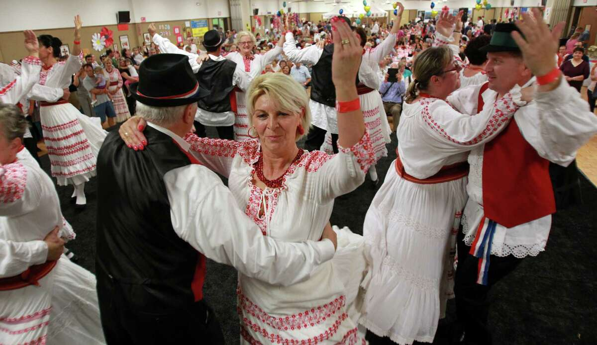 (Center) Merlina Jelinic performs with the Lone Star Croatian Dance Group during the 50th Annual Sts. Gyril & Methodius Slavic Heritage Festival held at Knights of Columbus Hall and Grounds on Sunday, Sept. 29, 2013, in Houston.