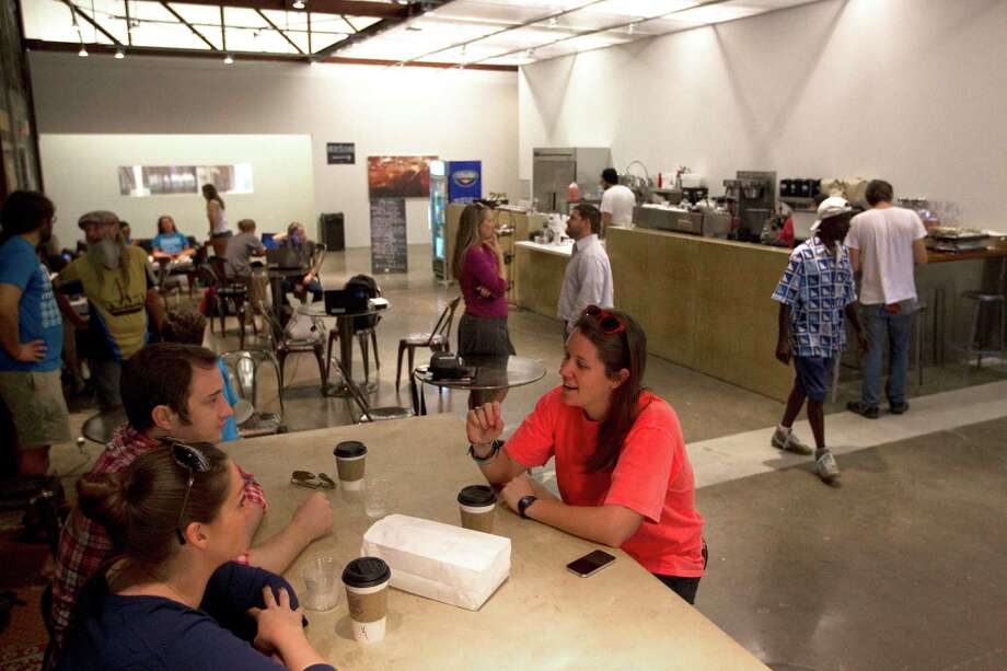 A new neighbor in the First Ward, the Paper Company coffee shop at Ecclesia Church found a home in a historic warehouse that was once a paper company in its early years Friday, Sept. 27, 2013, in Houston. Photo: Johnny Hanson, Houston Chronicle / Houston Chronicle