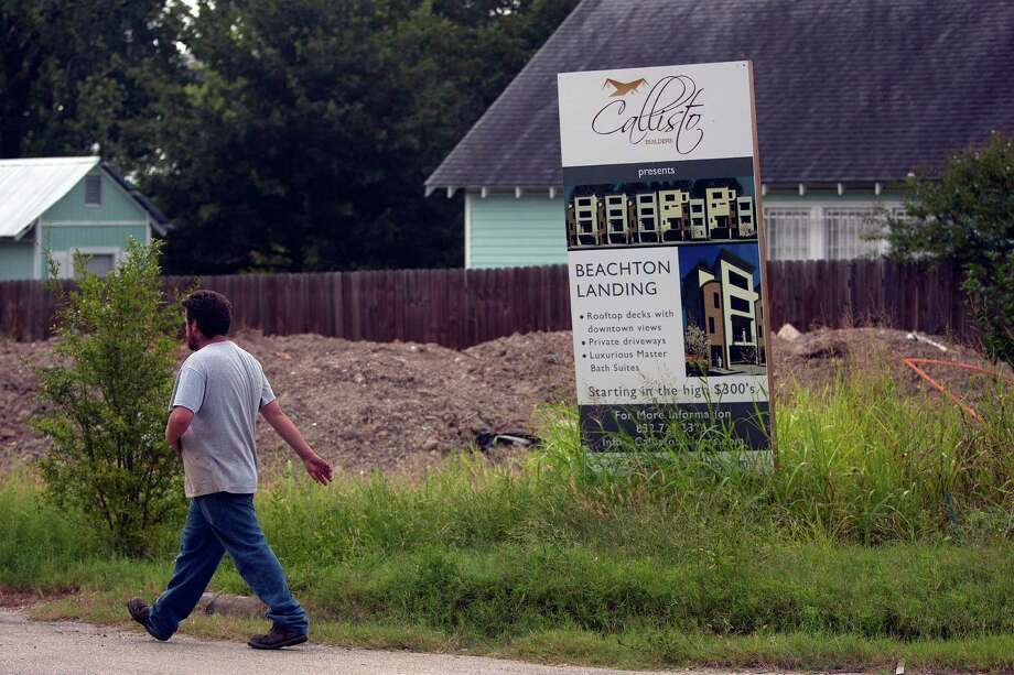 A construction worker walks past the site of a new planned  residential complex on the corner of Edwards and Beachton in the First Ward Friday, Sept. 27, 2013, in Houston. Photo: Johnny Hanson, Houston Chronicle / Houston Chronicle