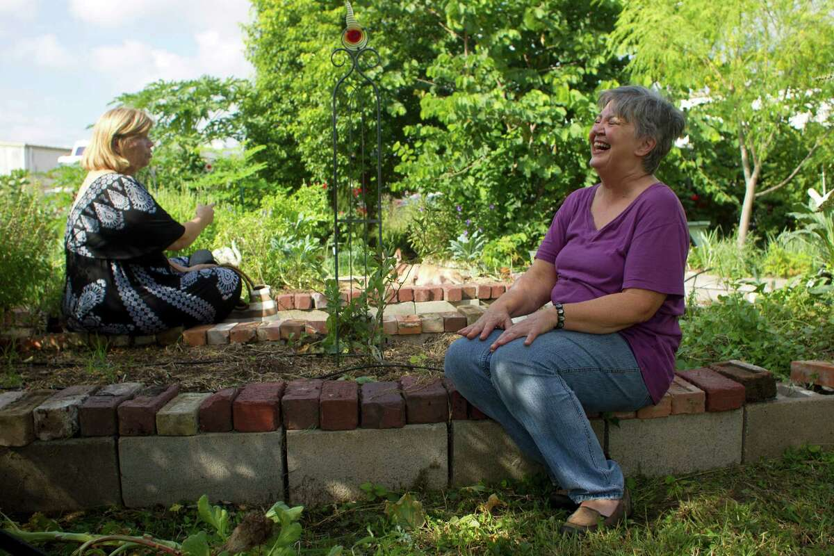 Janis Barnard, right, and Ludmila Ivanova, active First Ward residents, say they spend a lot of their time tending to the First Ward Community Garden found next to the former Jefferson Davis Hospital what is now the Elder Street Artist Lofts in the Friday, Sept. 27, 2013, in Houston.