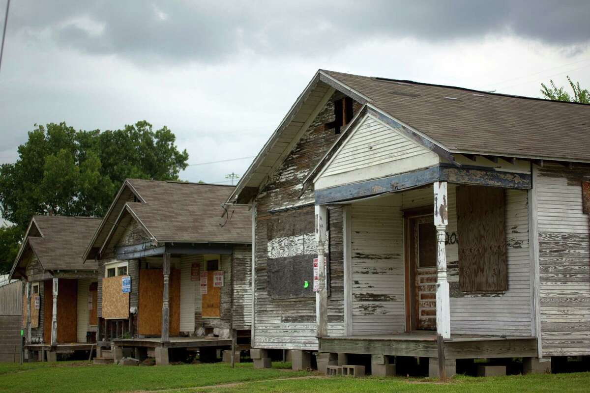 Row homes on Elder Street are now boarded up and for sale to be moved in the First Ward.