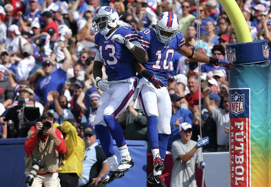 ORCHARD PARK, NY - SEPTEMBER 29: Robert Woods #10 of the Buffalo Bills celebrates his touchdown with Stevie Johnson #13 during NFL game action against the Baltimore Orioles at Ralph Wilson Stadium on September 29, 2013 in Orchard Park, New York. (Photo by Tom Szczerbowski/Getty Images) ORG XMIT: 175882294 Photo: Tom Szczerbowski / 2013 Getty Images