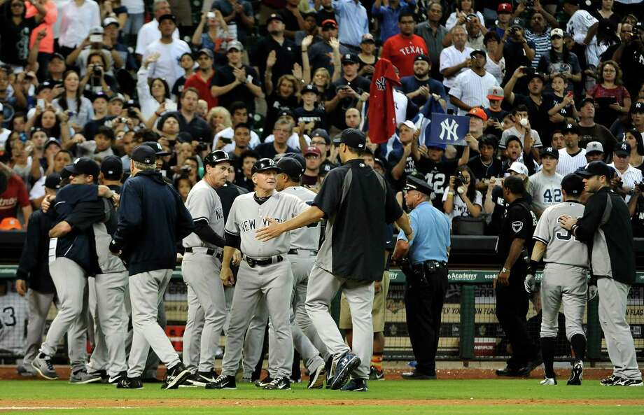 The New York Yankees leaves the field after beating the Houston Astros 5-1 in 14 innings for the last regular season baseball game for both teams, Sunday, Sept. 29, 2013, in Houston. (AP Photo/Pat Sullivan) ORG XMIT: HTA119 Photo: Pat Sullivan / AP