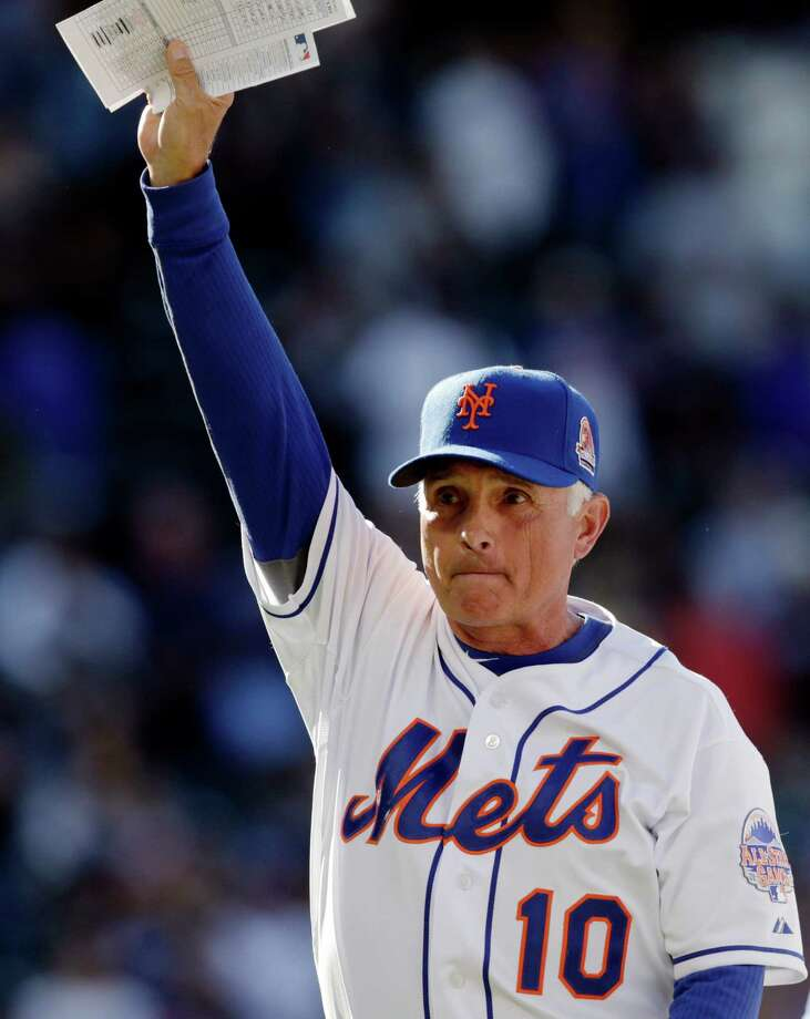 New York Mets manager Terry Collins (10) acknowledges the crowd after s 3-2 come-from-behind victory over the Milwaukee Brewers in a season-ending baseball game on Sunday, Sept. 29, 2013, in  New York. (AP Photo/Kathy Willens) ORG XMIT: NYM116 Photo: Kathy Willens / AP