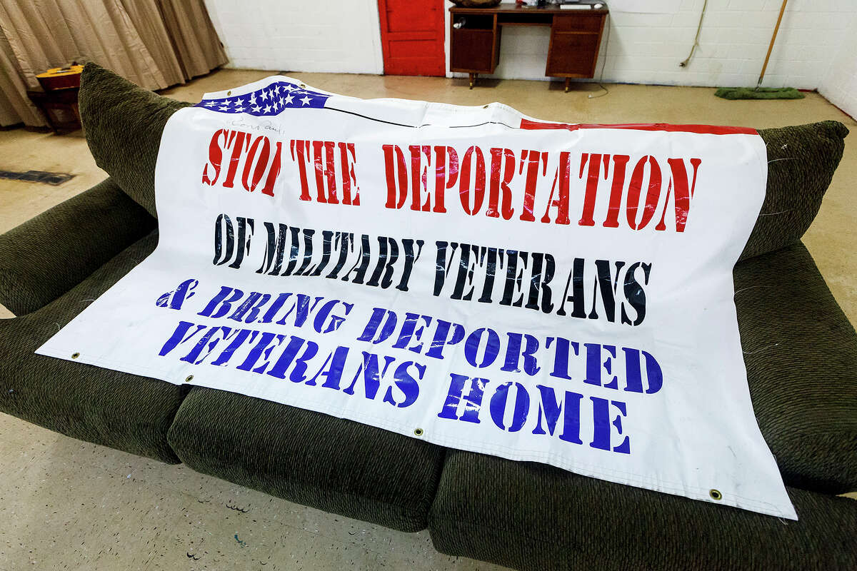 A banner on display while Manuel Valenzuela and his brother Valente Valenzuela were in San Antonio to tell their story about possible deportation at the Southwest Workers Union on Sunday, Sept. 29, 2013. The Valenzuelas, both highly honored retired Vietnam Veterans, are at risk for deportation due to a technicality that occured during childhood. Texas filmmaker John Valadez was on hand to film the event for possible incluwsion into the Balenzuela brothers' documentary. MARVIN PFEIFFER/ mpfeiffer@express-news.net