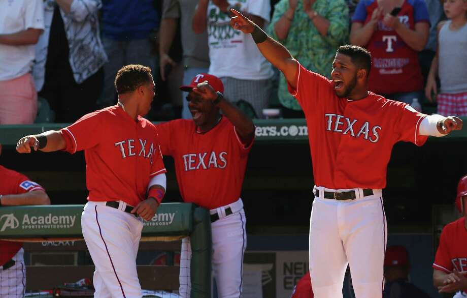 The Rangers' Leonys Martin, left, manager Ron Washington, center, and Elvis Andrus enjoy a sixth-inning run in Sunday's victory that sets up a play-in game against the Rays tonight at Arlington. Photo: Ronald Martinez, Staff / 2013 Getty Images