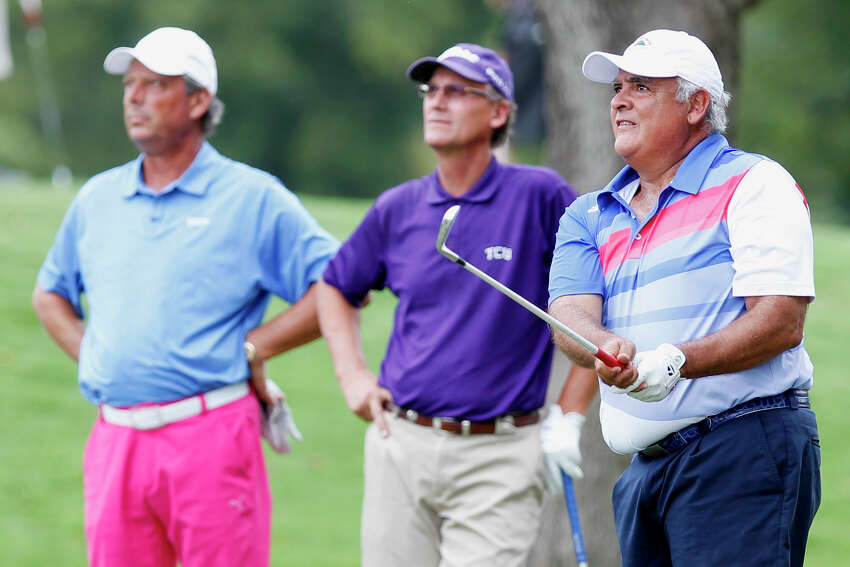 Harry Ramirez (right) follows his tee shot as Bobby Baugh (center) and Chuck Ellenwood watch on the 10th hole of the 2013 Greater San Antonio Senior Men's Championship golf tournament at Brackenridge Park Golf Course on Sunday, Sept. 29, 2013. Ramirez was tied with Baugh going into the final round but finished second to him by three strokes for the tournament.