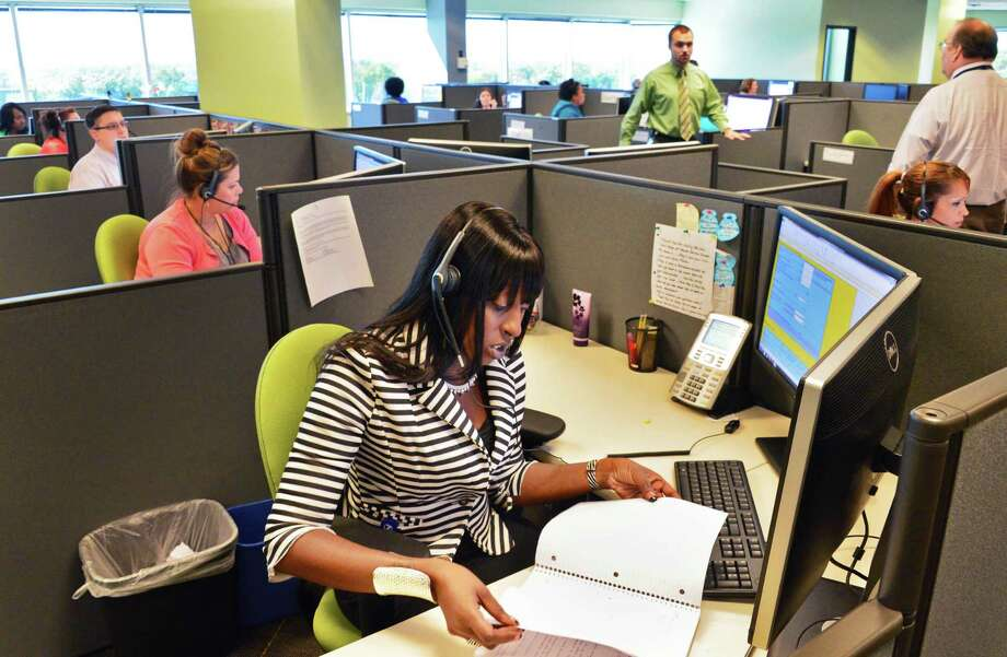 Consumer service specialist Shante Williams , takes questions about the new state-run health exchange at the Maximus call center Thursday Sept. 19, 2013, in Albany, NY.  (John Carl D'Annibale / Times Union) Photo: John Carl D'Annibale / 00023904A