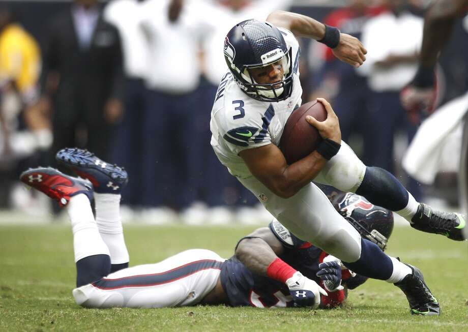 Seahawks quarterback Russell Wilson (3) is forced out of the pocket by Texans strong safety D.J. Swearinger (36). Photo: Brett Coomer, Houston Chronicle