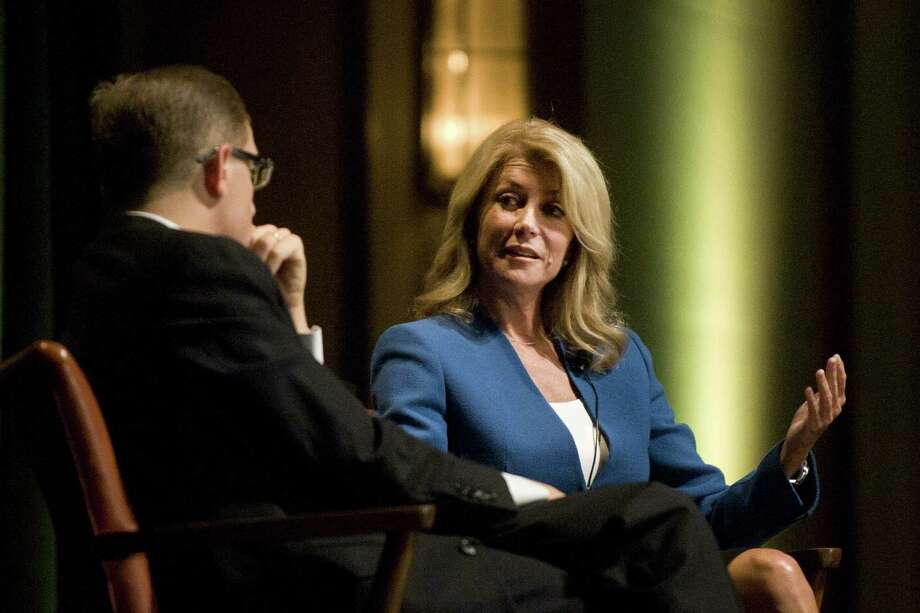 Wendy Davis, expected to announce her candidacy for governor Thursday, speaks with Texas Tribune CEO and editor in chief Evan Smith at the University of Texas in Austin. Photo: Erika Rich / Austin American-Statesman