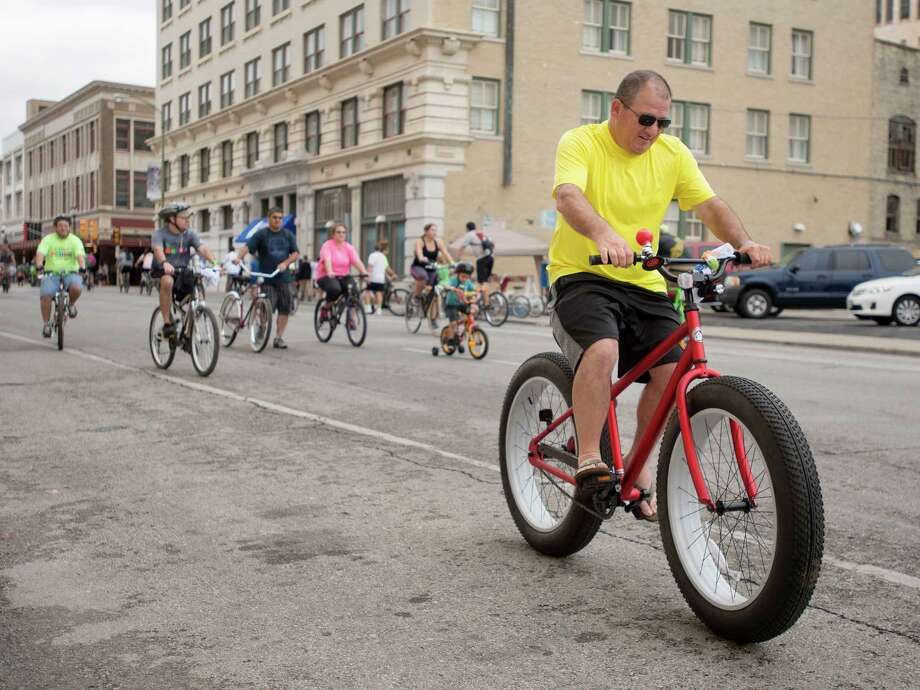 Health and fitnessCyclists ride their bicycles during Siclovia, a free event that turns city streets into safe places to exercise and play, Sept. 29, 2013, in Downtown San Antonio.  Photo: Photo By Darren Abate/Express-News
