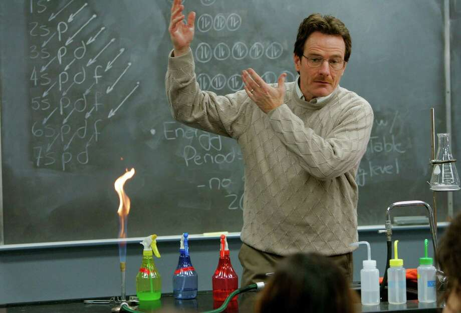 "This image released by AMC shows Walter White, played by Bryan Cranston, teaching chemistry class in a scene from the pilot episode of ""Breaking Bad.""  The series finale of the popular drama series airs on Sunday, Sept. 29. Photo: AMC, Doug Hyun"