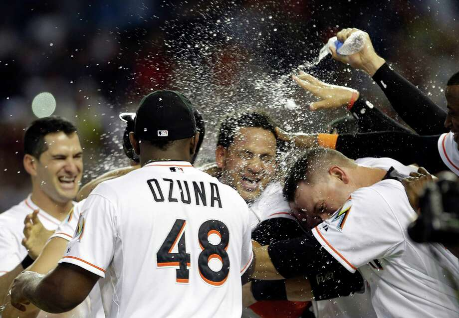 Marlins starter Henderson Alvarez, center, makes a splashy exit by throwing the fifth no-hitter to come on the final day of the season. Photo: Alan Diaz, STF / AP