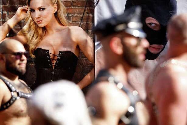 Posters advertising specialty clothing are seen at last year's Folsom Street Fair in S.F.