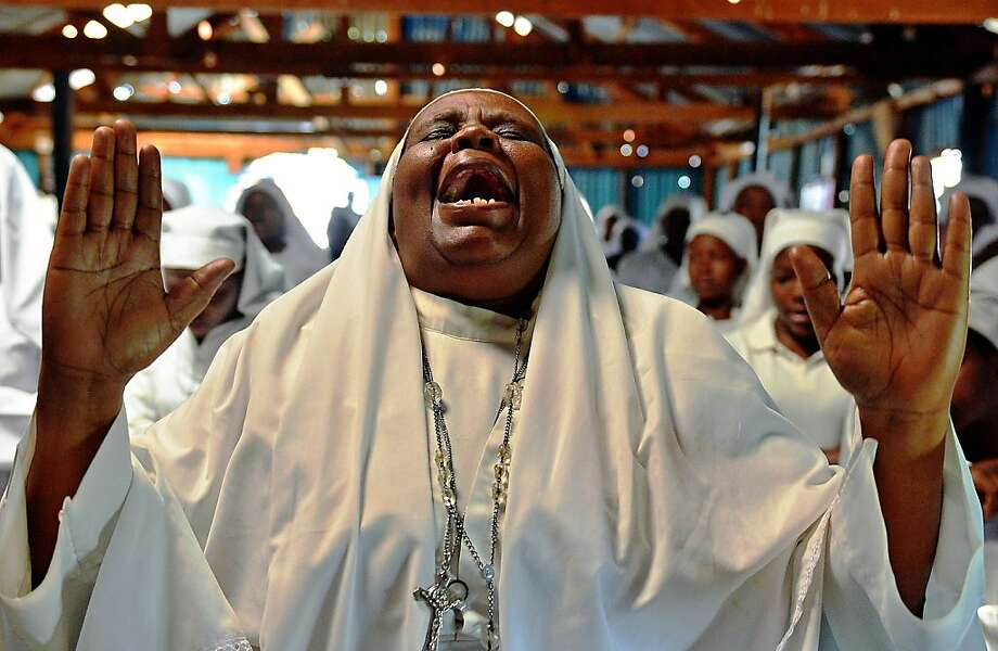 TOPSHOTS-A woman screams during a special prayer for the victims of the Westgate mall massacre at the Legio Maria African Mission church on September 29, 2013, in Nairobi. Pressure mounted on the Kenyan authorities a week after the Nairobi mall carnage amid questions over the fate of the missing and accusations on September 28 that top brass failed to heed security warnings.  AFP PHOTO / CARL DE SOUZACARL DE SOUZA/AFP/Getty Images Photo: Carl De Souza, AFP/Getty Images