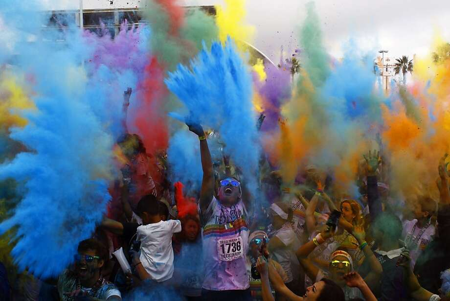 Runners dance and cheer during the festival of color after the Color Run on September 29, 2013 in Guadalajara, Mexico. Considered the world's most joyful 5km race, in which every kilometre a powder of a different dye is thrown in the air at the runners' passage, the event takes place in Mexico for the first time.     TOPSHOTS/AFP PHOTO/Hector GuerreroHECTOR GUERRERO/AFP/Getty Images Photo: Hector Guerrero, AFP/Getty Images