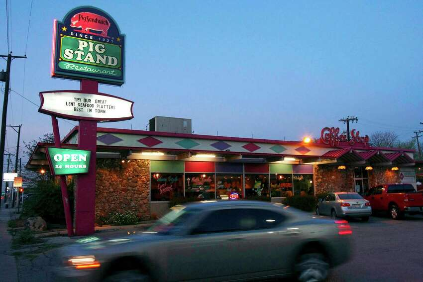 A car passes the Pig Stand restaurant in San Antonio on March 21, 2008. The restaurant chain was started in 1921 and at its peak before the Great Depression, and had about 130 restaurants across the country. This is the only one remaining.
