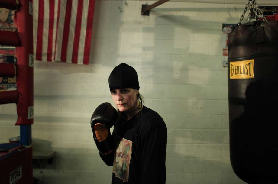 Professional boxer Laura Deanovic, 46, works out at the Third Street Boxing gym in San Francisco, Calif. Deanovic turned pro two years ago shortly after winning the National Golden Gloves Championship in the Masters Division.  She had never boxed before the age of 40. Photo: Mike Kepka, The Chronicle