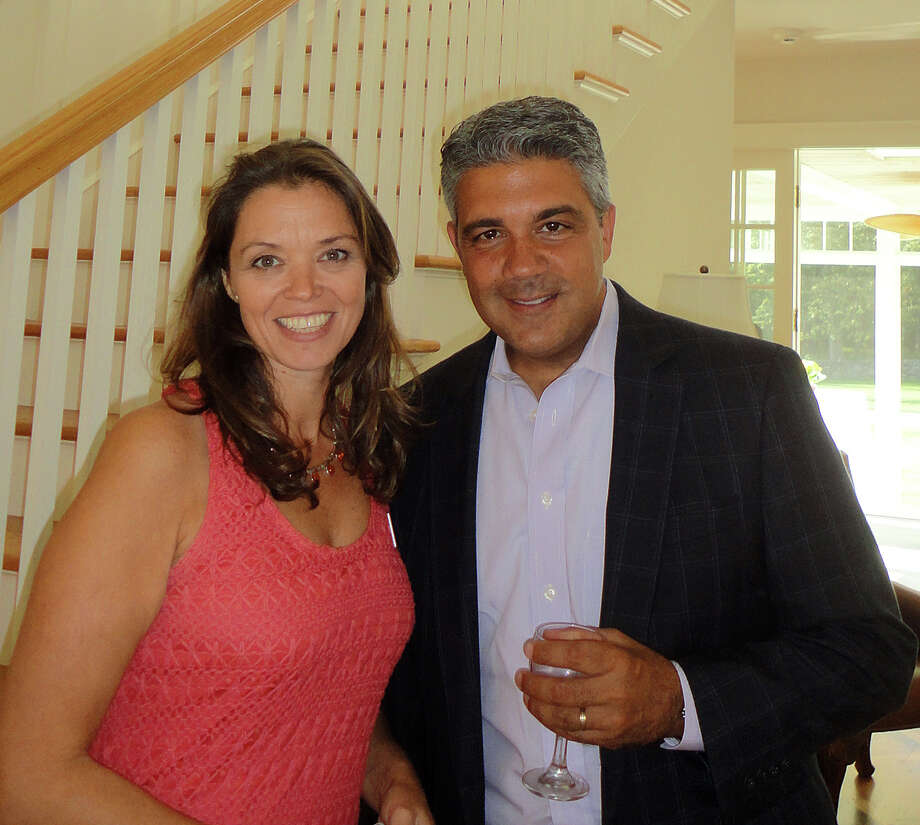 Julie Vanderblue of the Vanderblue Team, an affiliate of Higgins Group Real Estate, with Brett Ciarlo, an agent with Christie's International Real Estate in New Canaan, at a Greenfield Hill estate on Congress Street in Fairfield, where Vanderblue hosted a reception Sunday after a tour of luxury houses to raise money for Operation Hope. Photo: Meg Barone / Fairfield Citizen contributed