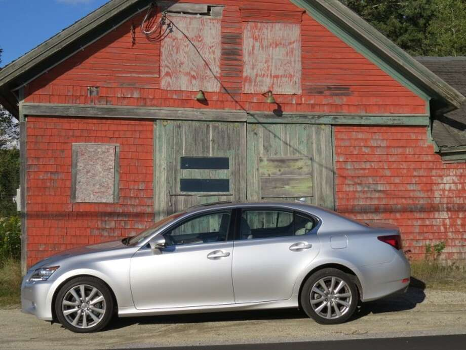 The 2013 Lexus GS350 AWD in front of an old garage in Brooklin, Maine, on a recent afternoon.  (All photos by Michael Taylor)