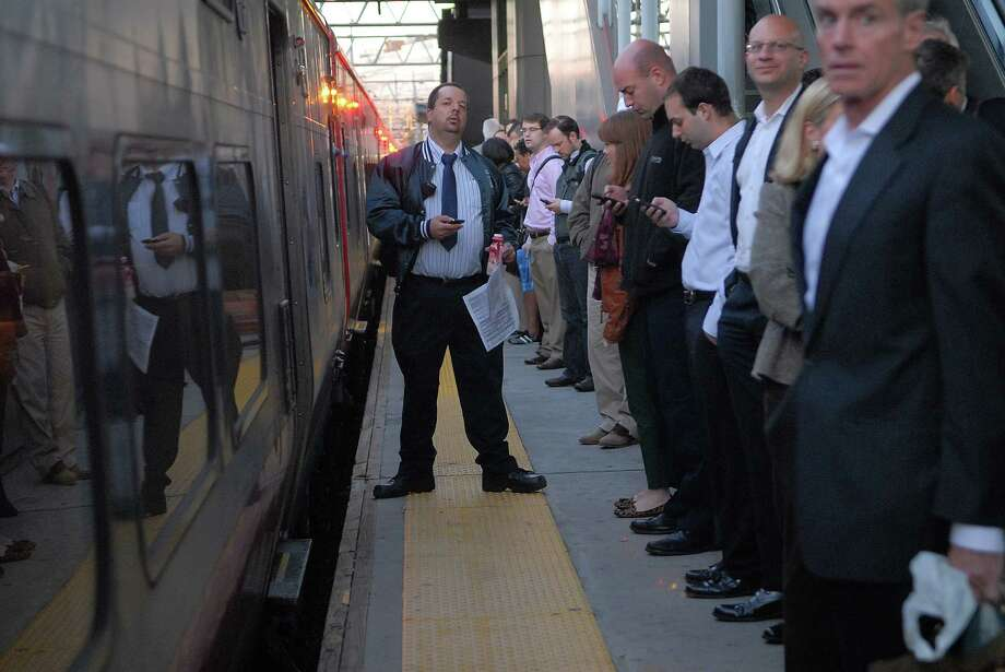 Commuters wait for the train to Grand Central Station  in Stamford, Conn. on Monday September 30, 2013, partial service has been restored after the failure of an electric feeder cable on the New Haven line. Photo: Dru Nadler / Stamford Advocate Freelance