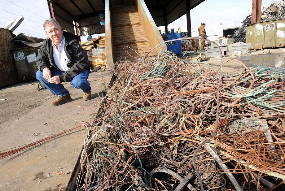 The high cost of scrap metals has materials like copper being stolen from churches and business in recent months. Scrap metal dealer Mel Wright, shown, reports material that he believes to be stolen. Guiseppe Barranco/The Enterprise Photo: Guiseppe Barranco / Beaumont