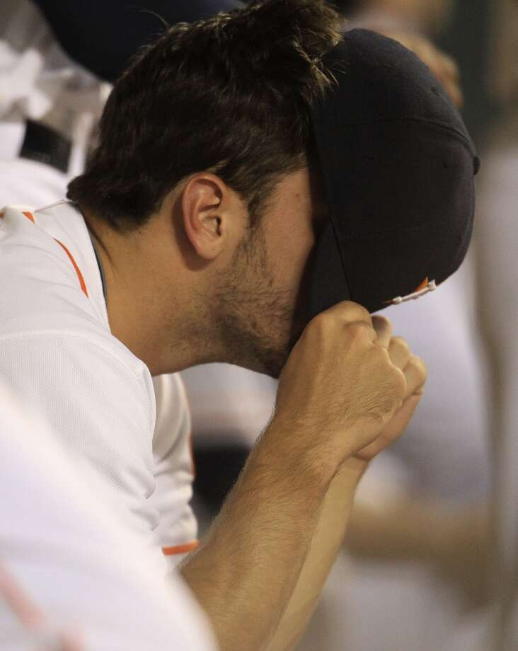 Sept. 29 - Jarred Cosart couldn't bear to watch as they Astros close the worst season in franchise history with a 14-inning loss to the Yankees. The Astros head into the offseason on a franchise record 15-game losing streak. Photo: Karen Warren, Houston Chronicle