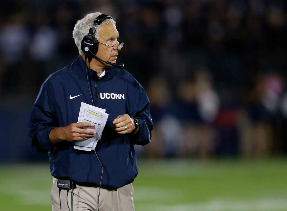 Paul Pasqualoni, coach of the Connecticut Huskies at Rentschler Field on September 21, 2013 in East Hartford, Connecticut.  UConn head football coach Paul Pasqualoni has been fired. UConn athletic director Warde Manuel made the announcement in an e-mail statement released Monday morning. An interim coach will be announced later this afternoon. Photo: Jim Rogash, Jim Rogash/Getty Images / 2013 Getty Images