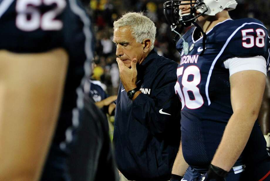 Connecticut head coach Paul Pasqualoni, center, reacts at the end of thecollege football game against Michigan at Rentschler Field, Saturday, Sept. 21, 2013 in East Hartford, Conn. Michigan won 24-21. UConn head football coach Paul Pasqualoni has been fired.