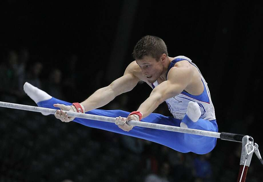 Gymnast Arnaud Willig from France performs on the horizontal bar, during the qualification round at the artistic gymnastics World Championships in Antwerp, Belgium, Monday, Sept. 30, 2013. The event takes place from Sept. 30, until Sunday, Oct. 6. Photo: Yves Logghe, Associated Press