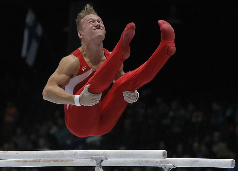 Gymnast Joao Fuglsig from Denmark performs on the parallel bars, during the qualification round at the artistic gymnastics World Championships in Antwerp, Belgium, Monday, Sept. 30, 2013. The event takes place from Sept. 30, until Sunday, Oct. 6. Photo: Yves Logghe, Associated Press