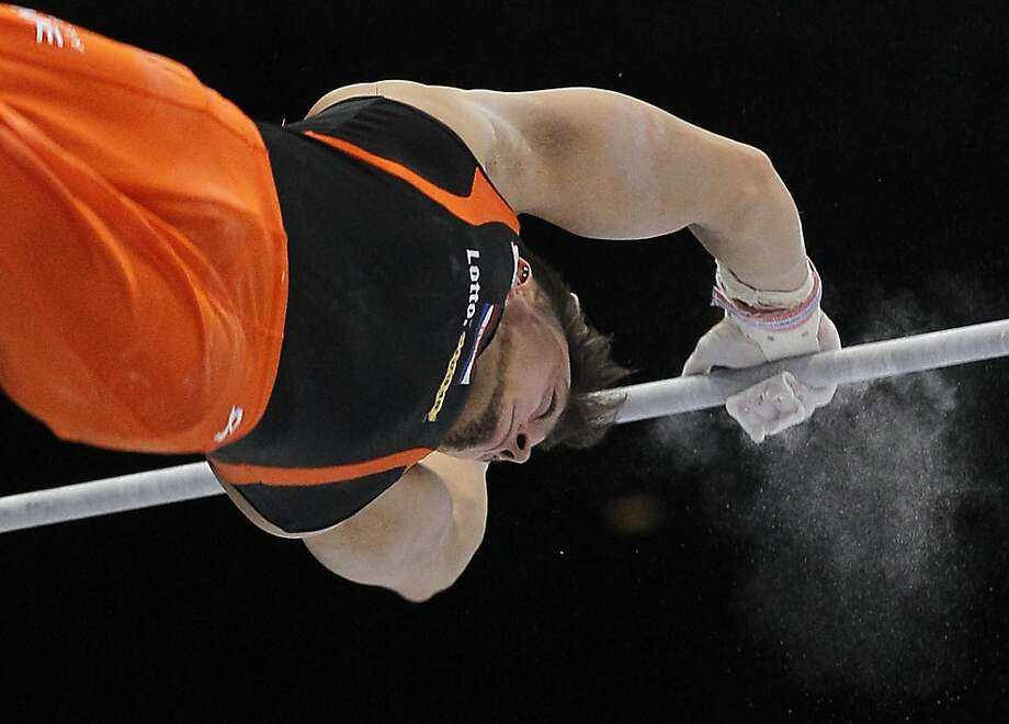 Bart Deurloo from the Netherlands performs on the horizontal bar during the qualification round at the artistic gymnastics World Championships in Antwerp, Belgium, Monday, Sept. 30, 2013. The event takes place from Sept. 30, until Sunday, Oct. 6. Photo: Yves Logghe, Associated Press