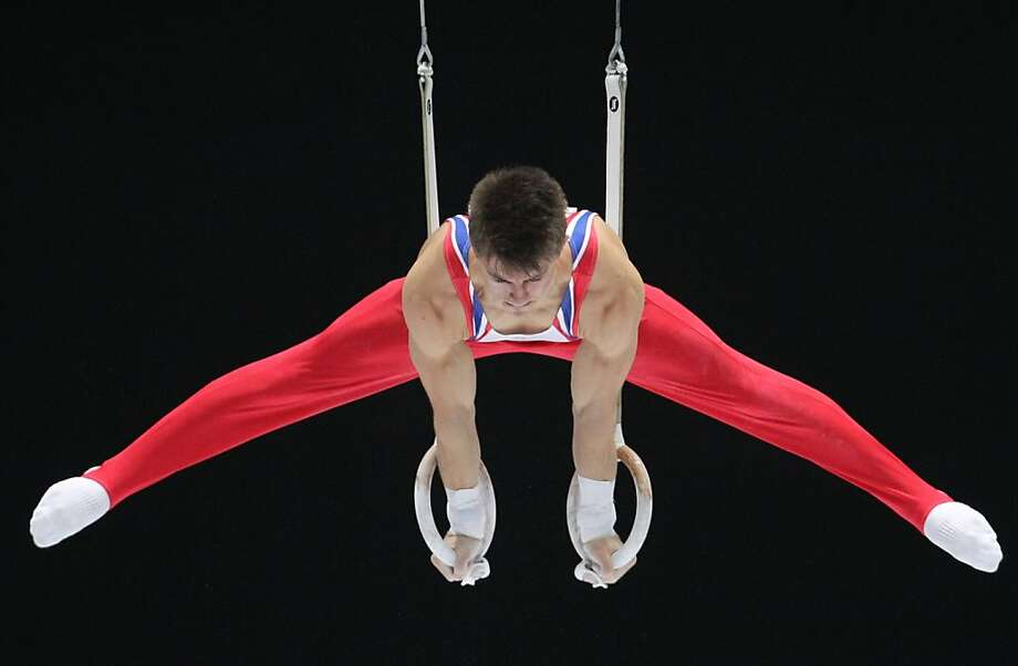 Max Whitlock from Britain performs the rings exercise during the qualification round at the artistic gymnastics World Championships in Antwerp, Belgium, Monday, Sept. 30, 2013. The event takes place from Sept. 30, until Sunday, Oct. 6. Photo: Yves Logghe, Associated Press